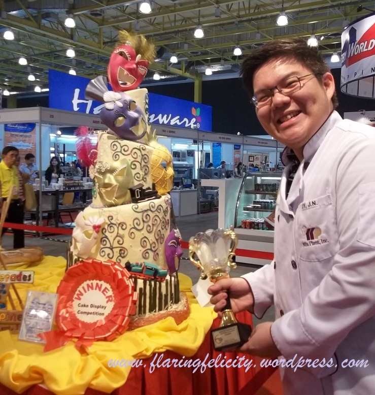 James Uy with his trophy and winning cake