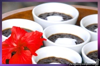 Bubur Injin is black rice pudding in Indonesia. It is sweetened with coconut sauce and palm sugar.