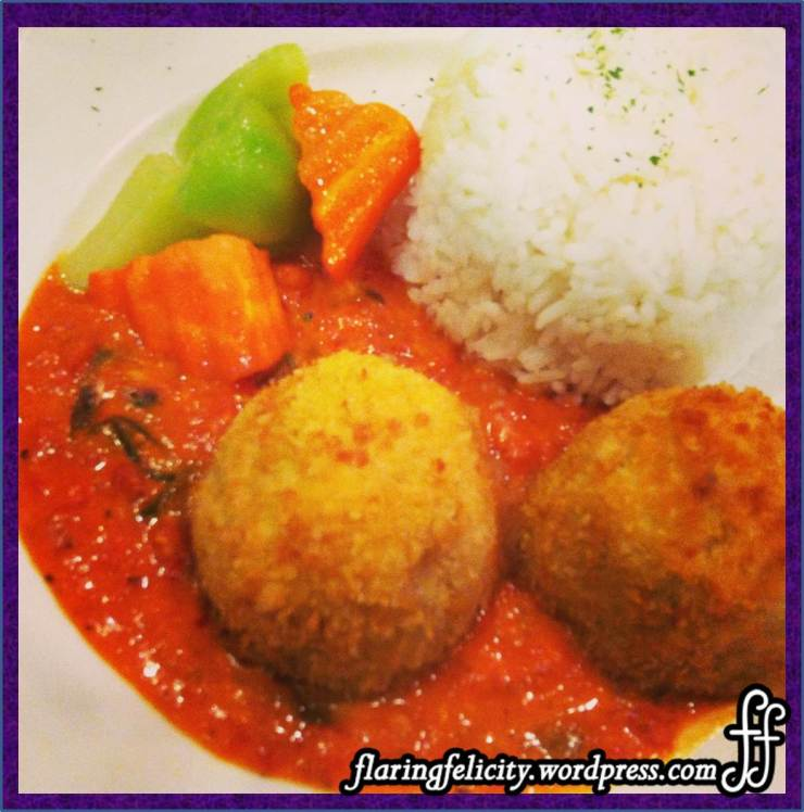 Salisbury steak - hard boiled egg wrapped with ground beef, topped with roasted tomato and vegie sauce