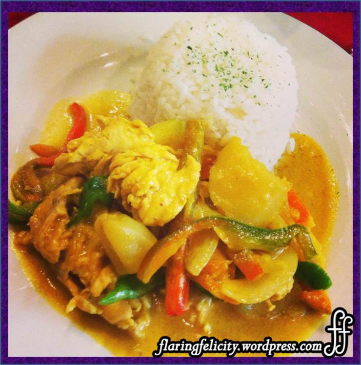 Sauted chicken in light curry sauce with roasted potatoes, capsicum and onion
