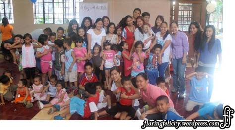 Group shot with the sponsors, kids and event organizers